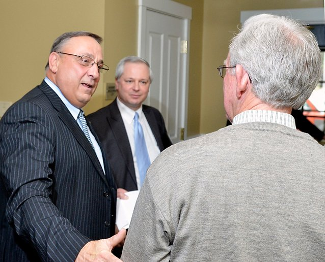 Gov. Paul LePage chats with Charles Wallace, president of Resource Systems Engineering in Brunswick, one of many business leaders who attended Wednesday's event hosted by Southern Midcoast Maine Chamber, which took place at the Inn at Brunswick Station. At center is John Butera, LePage's senior economic adviser.