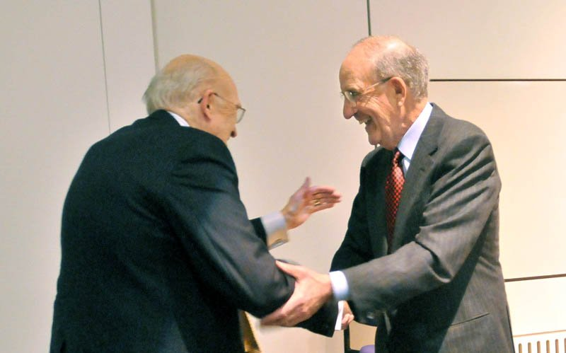 Sen. George J. Mitchell, right, introduces former U.S. Senator Alan K. Simpson to deliver the 2013 George J. Mitchell Distinguished International Lecture at Ostrove Auditorium at Colby College Wednesday.