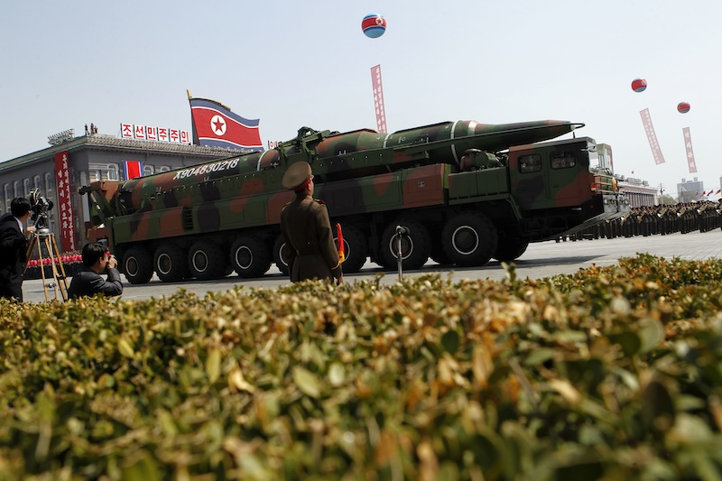 In this Sunday, April 15, 2012 file photo, a North Korean vehicle carrying what appears to be a new missile passes by during a mass military parade in Pyongyang's Kim Il Sung Square to celebrate the centenary of the birth of the late North Korean founder Kim Il Sung. U.S. defenses could intercept a ballistic missile launched by North Korea if it decides to strike, the top American military commander in the Pacific said Tuesday. (AP Photo/Ng Han Guan, File)