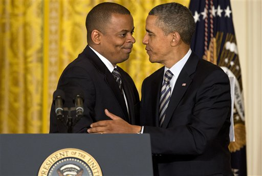 President Barack Obama embraces Charlotte, N.C., Mayor Anthony Foxx at the White House on Monday. The president announced he would nominate Foxx to succeed Ray LaHood as transportation secretary.