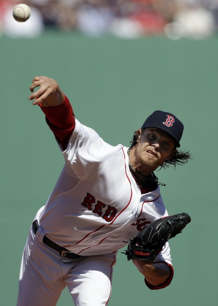 Boston Red Sox starting pitcher Clay Buchholz (11) delivers to the Baltimore Orioles during the first inning of a baseball game at Fenway Park in Boston, Monday, April 8, 2013. (AP Photo/Elise Amendola) Fenway Park
