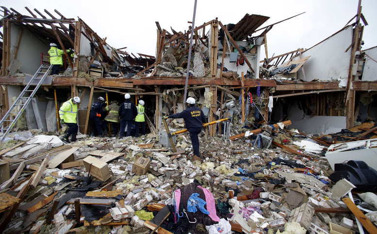 Firefighters search the debris of an apartment complex destroyed by an explosion at a fertilizer plant in West, Texas, on Thursday.