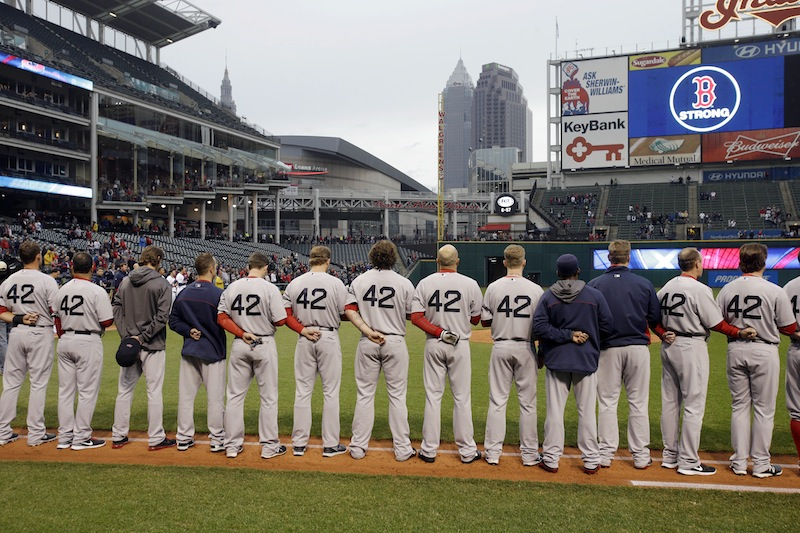 The Boston Red Sox players and coaches observe a moment of silence for the victims of the Boston bombings before a baseball game against the Cleveland Indians Tuesday, April 16, 2013, in Cleveland. (AP Photo/Mark Duncan) Progressive Field