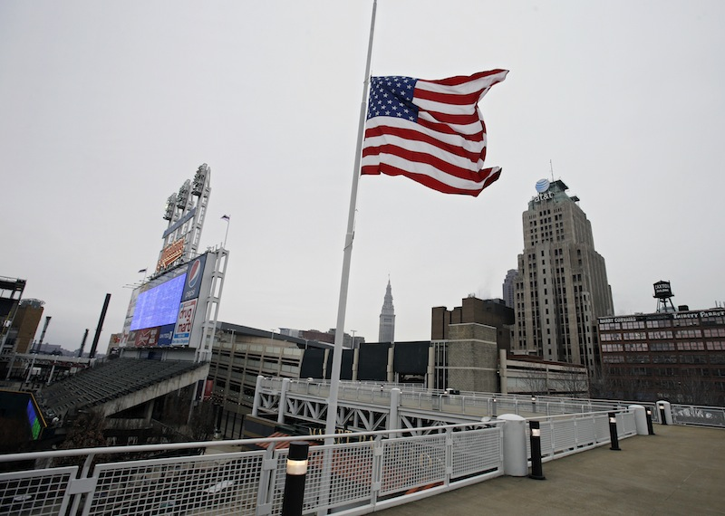 A United States flag flies at half mast for the victims of the Monday bombing at the Boston Marathon, on Tuesday, April 16, 2013, at Progressive Field in Cleveland before a baseball game between the Boston Red Sox and Cleveland Indians. (AP Photo/Mark Duncan) Progressive Field