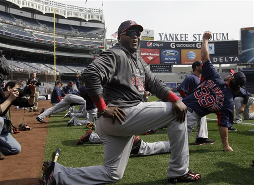 Boston Red Sox designated hitter David Ortiz jokes with reporters on the field before the Red Sox Opening Day baseball game against the New York Yankees at Yankee Stadium in New York on Monday.