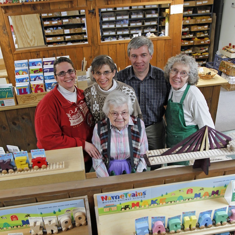 In this Friday, Feb. 22, 2013, photo, Mike Rainville poses with his family members at the Maple Landmark Woodcraft factory in Middlebury, Vt. Rainville works with multiple generations of his family at the factory. Experts say family businesses are more resilient when times are tough because of relative's commitment, passion and knowledge of the business. (AP Photo/Toby Talbot)