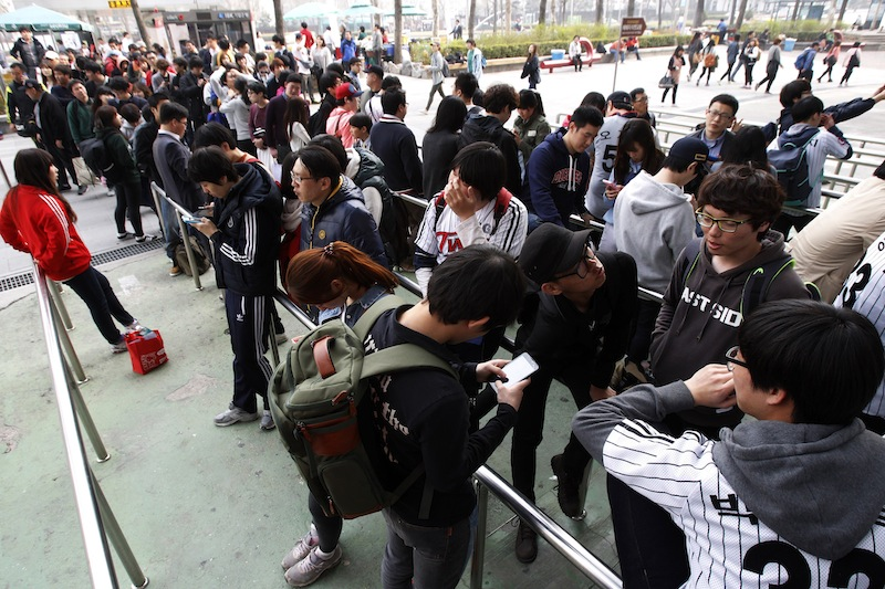 People line up to buy tickets for a pro baseball game at the Jamsil Baseball Stadium in Seoul, South Korea on Friday. Outsiders might hear the opening notes of a war in the deluge of threats and provocations from North Korea, but to South Koreans it is a familiar song.