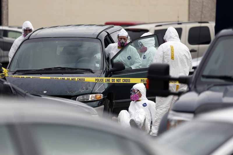 Federal agents inspect the Dodge Grand Caravan driven by Everett Dutschke near the site of a martial arts studio he once operated, Wednesday, April 24, 2013 in Tupelo, Miss., in connection with the investigation into poisoned letters mailed to President Barack Obama and others. Dutschke has not been arrested or charged. (AP Photo/Rogelio V. Solis)