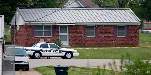 A city of Corinth police car prevents access to a house in Corinth, Miss., on Thursday morning after authorities arrested Paul Kevin Curtis under the suspicion of sending letters covered in ricin to President Barack Obama and others.
