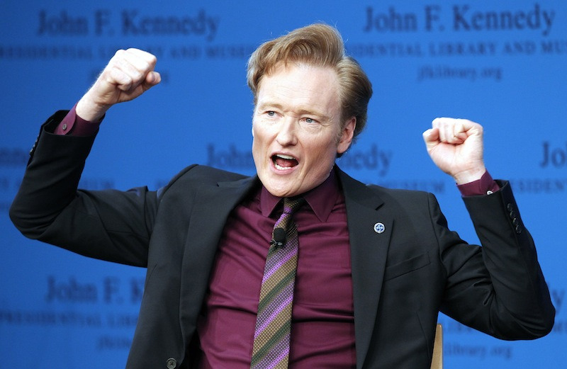 This May 24, 2012 file photo shows late night talk show host Conan O'Brien speaking during a forum at the John F. Kennedy Presidential Library in Boston. TBS says it's extending Conan O'Brien's late-night hour through November 2015.