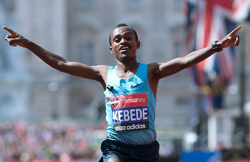 Tsegaye Kebede of Kenya puts his arms out as he celebrates after winning the men's London Marathon on Sunday,