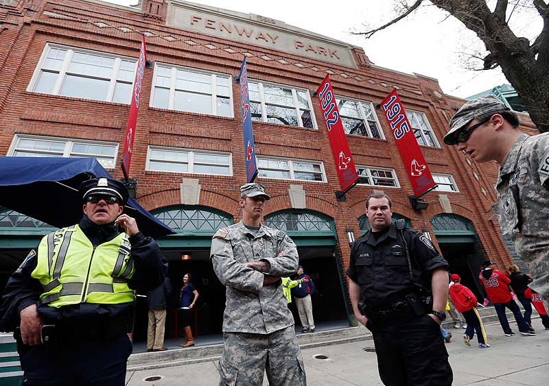 Police and National Guard soldiers stand outside Fenway Park before Boston's game Saturday against the Kansas City Royals.