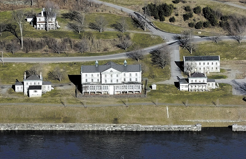 Staff photo by Joe Phelan This 2007 file aerial photo shows the Kennebec Arsenal in Augusta. It was taken during a minor spring flood and so the granite pier, bottom right, is covered by Kennebec River. kennebec arsenal aerial business government hallowell warm weather
