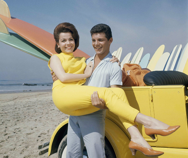 Actress Annette Funicello with singer Frankie Avalon on Malibu Beach, Calif., during the 1963 filming of