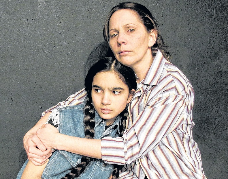 """Beth Chasse comforts Angela Moline in """"Little Sister,"""" which runs through April 28."""