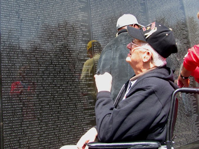 Richard Leighton of Westbrook stares up at the name of his brother, Sgt. Raymond Leighton, engraved on the Vietnam Veterans Memorial in Washington, D.C., on Sunday. Leighton, who is terminally ill with cancer, was able to visit the memorial for the first time with Honor Flight New England, a nonprofit that flies veterans of World War II and other terminally ill veterans to Washington for free.