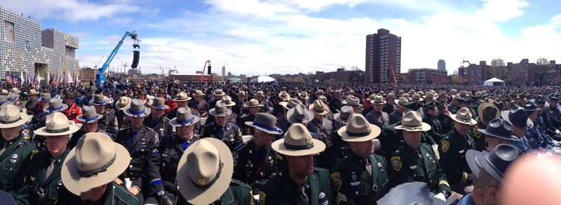 Hundreds of police from around the region, including from Maine, gather at a memorial for campus police officer Sean Collier in Cambridge on Wednesday. Collier was slain last week in the aftermath of the Boston Marathon bombings.
