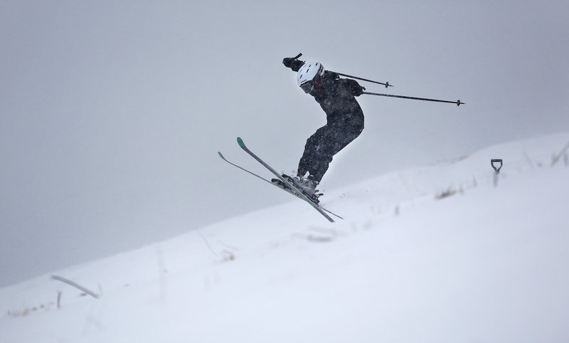 Snow enthusiasts like this February skier in Portland enjoyed the abundance of snowfall this winter. Ski areas say they've seen increased business due to numerous winter storms and many are still open for late-season runs.