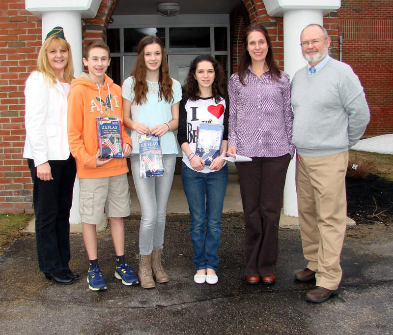 Three Wells Junior High students were cited for their entries in an Americanism essay contest. From left, Deb Coady of the Amvets, students Wesley Moody, Kayla Looper and Emily Cottis, their teacher Julie Esch and Principal Chris Chessie.
