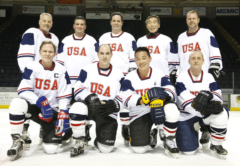 Takahiro Sato, owner of Yosaku restaurant, has arranged for his Maine men's league hockey team to go to Japan to play former Japanese Olympians to raise money for young victims of the 2011 earthquake and tsunami. Team members include, left to right in back row, Mark Hews, Joe Ouellette, Jeff Milburn, Takahiro Sato and James Witham, and in front row, John Whitman, Brian Marcaurelle, Steve Tsujiura, who played for the Maine Mariners, and Thomas Hall.