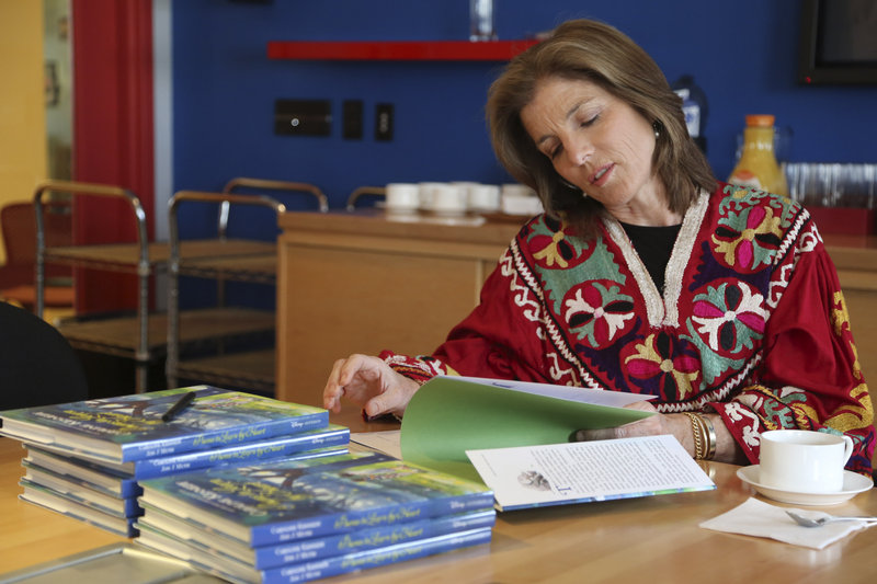 Caroline Kennedy flips through her 10th book,