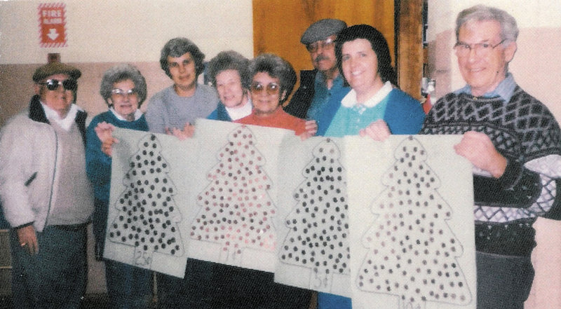 Pantry volunteers in 1998, including Herbert Scribner, right, whose son Mark contributed $25,000 in his father's honor. The others, from left: Bill Nye, Marie Nye, Nancy Marcoux, Marcel Donahue, Juliette Gauthier, Dick Tompkins and Suzie Caverley.
