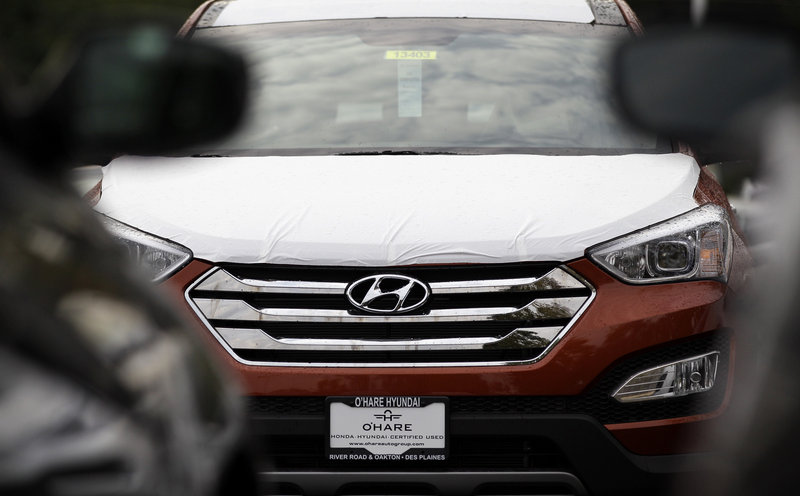 A Hyundai Sonata is seen outside a Hyundai car dealership last October in Des Plaines, Ill. For nearly two decades, the Toyota Camry and the Honda Accord have ruled the midsized car market. But now the dominance is starting to slip.