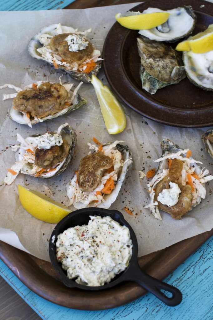 """Fried"" Guinness-battered oysters sizzle with the heat of a spicy mustard. The oysters are sauteed in just a tablespoon of oil, far less than is required for deep frying."