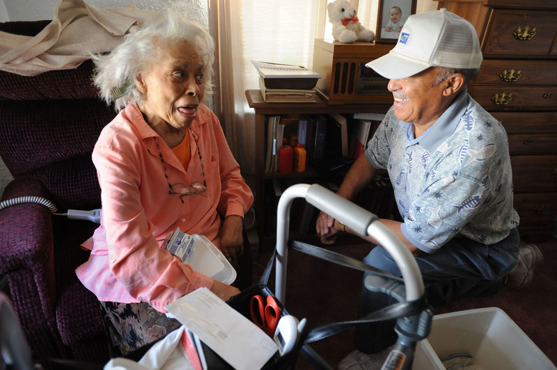 A Meals on Wheels client in Charleston, W.Va., visits with the man who delivered her meal, in 2008. A volunteer with the program in Brunswick says sequester-related funding cutbacks will affect the frequency of meal deliveries and well-being checks.