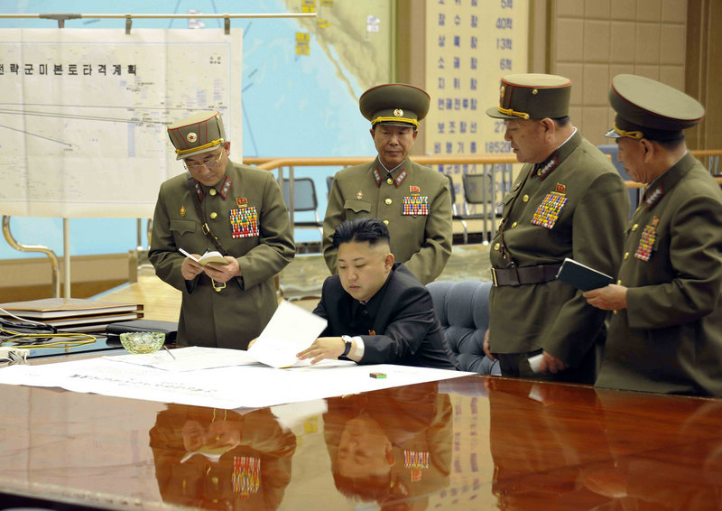 Kim Jong Un, center, presides over an operation meeting at the Supreme Command in Pyongyang, North Korea, on March 29. Analysts say Un could be trying to appease military hard-liners in his country by threatening the United States.