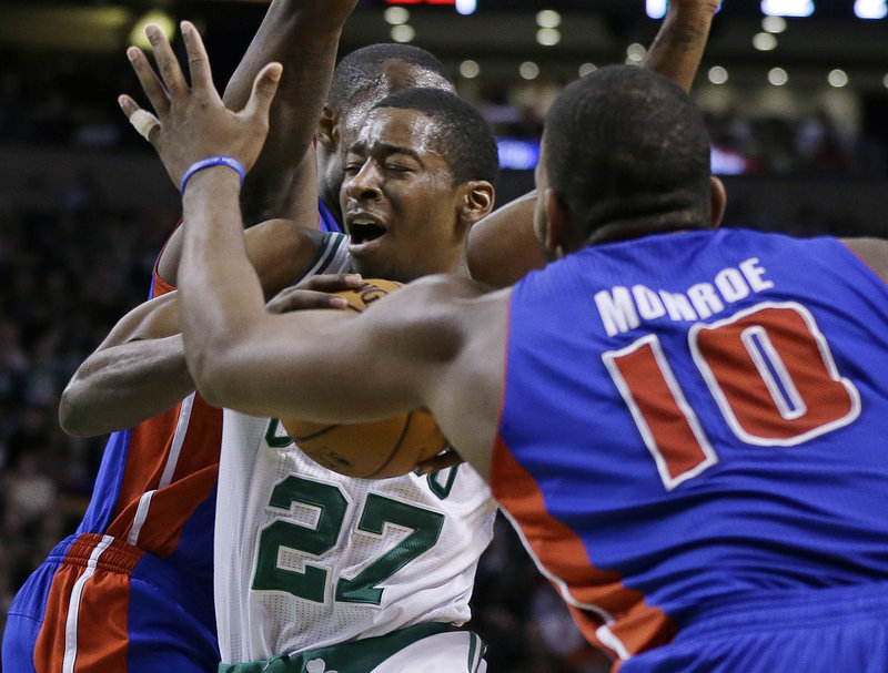 Boston's Jordan Crawford drives between two Detroit defenders in the Celtics' 98-93 win Wednesday at Boston.