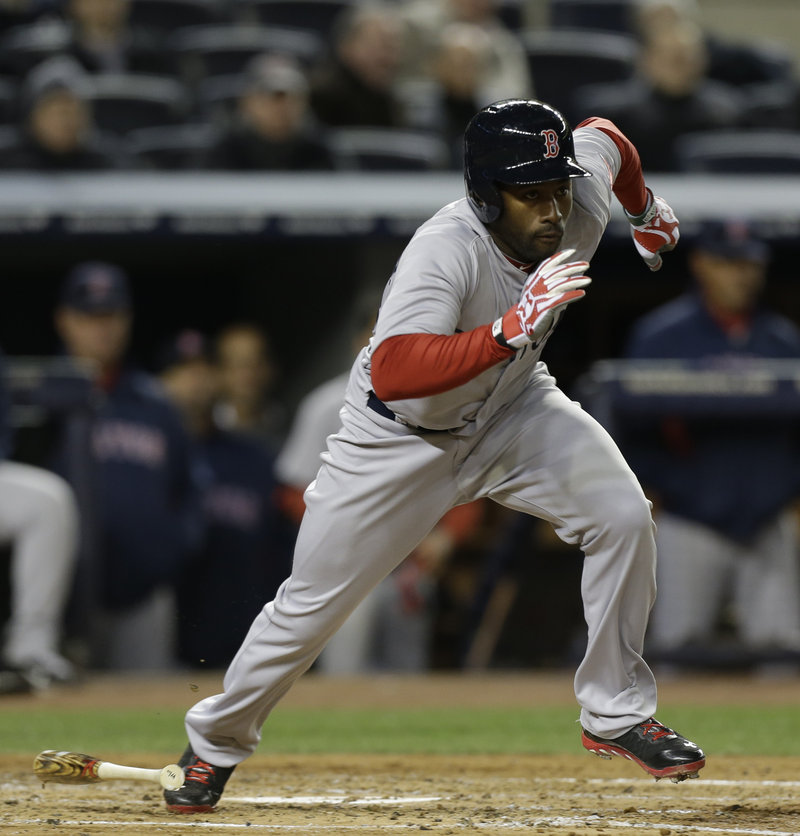Jackie Bradley Jr. sprints to first base Wednesday night after driving the ball up the middle in the third inning, driving in a run with his first major league hit as the Boston Red Sox beat the New York Yankees.
