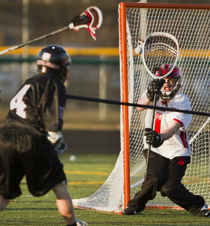 Scarborough goalie David Pearson keeps his eye on a shot Thursday during a lacrosse scrimmage against Mercer Island, Wash. Mercer Island has traveled on spring break for 11 of the past 12 years in search of quality competition.