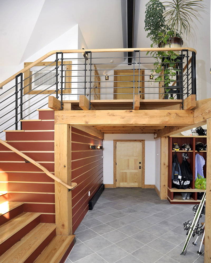 The mudroom has a door leading in from the outside. The rest of the home is accessible from a set of stairs.