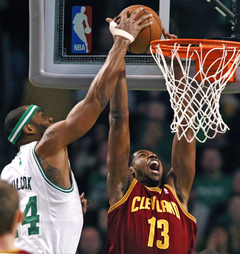 Boston center Chris Wilcox and Cleveland's Tristan Thompson battle under the boards during Friday's game in Boston, won by the Cavaliers, 97-91.