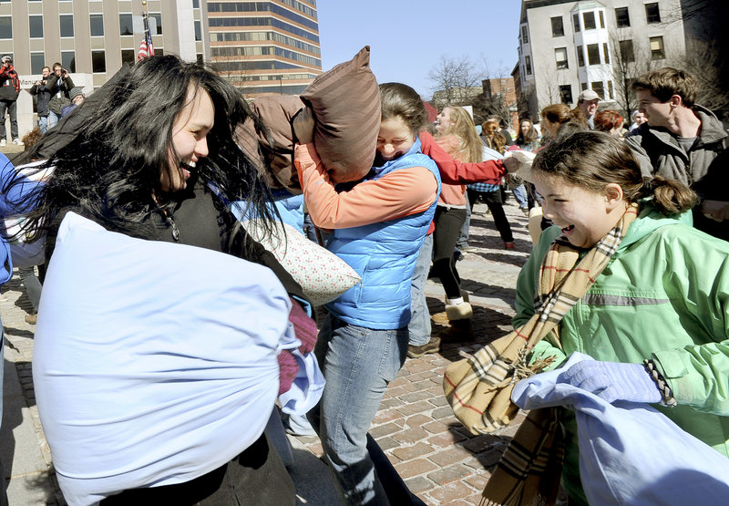 Elaine Akers and her daughter Avis, 11, of Portland, show their delight with the pummeling.