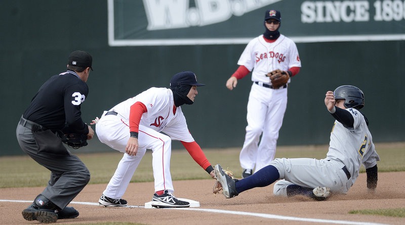 Portland's Kolbrin Vitek puts a textbook tag on Trenton's Tyler Austin at third base, as Austin was called out trying to advance during Trenton's 9-7 win at Hadlock Field on Sunday.