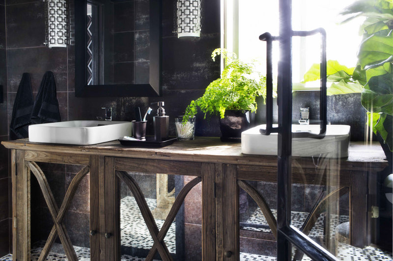 Designer Brian Patrick Flynn used maidenhair ferns in this bathroom – a dark space that receives little direct sunlight. Flynn suggests using ferns to add life to a room without the feminine look associated with flowers.