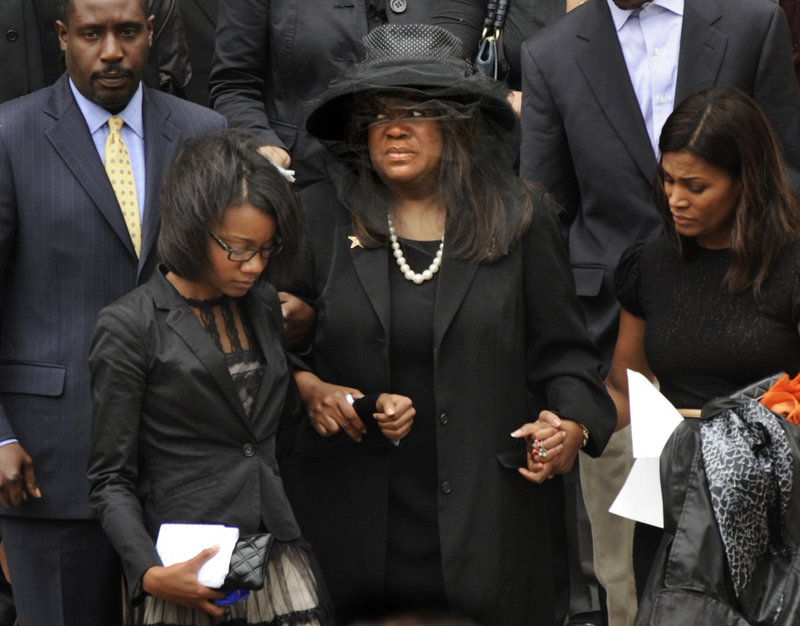 Chaz Ebert, center, wife of film critic Roger Ebert, leaves Holy Name Cathedral after his funeral Mnday in Chicago. Roger Ebert died Thursday.