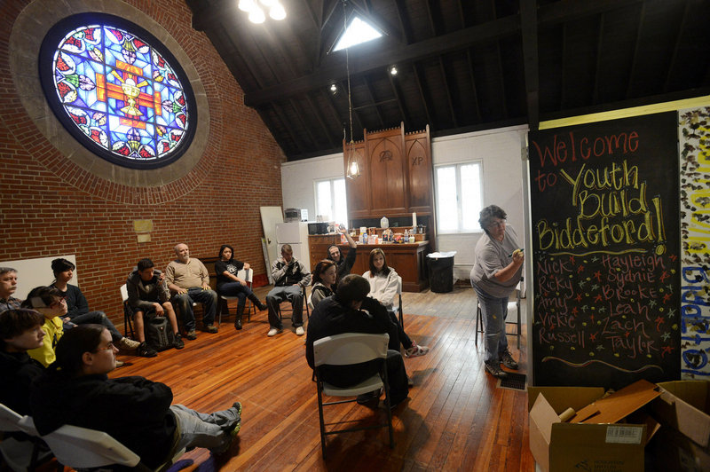Nancy Kopack, director of YouthBuild Biddeford, goes over the daily planning with students and faculty during a circle meeting at the alternative high school for at-risk youth Tuesday, April 9, 2013.