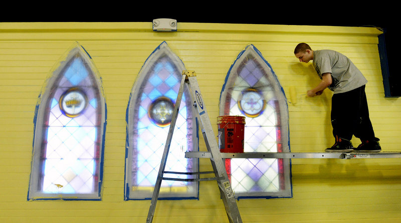 Russell Brown 16, of YouthBuild Biddeford, paints the interior of YouthBuild Biddeford (formerly Christ Episcopal Church) on Tuesday, April 9, 2013.