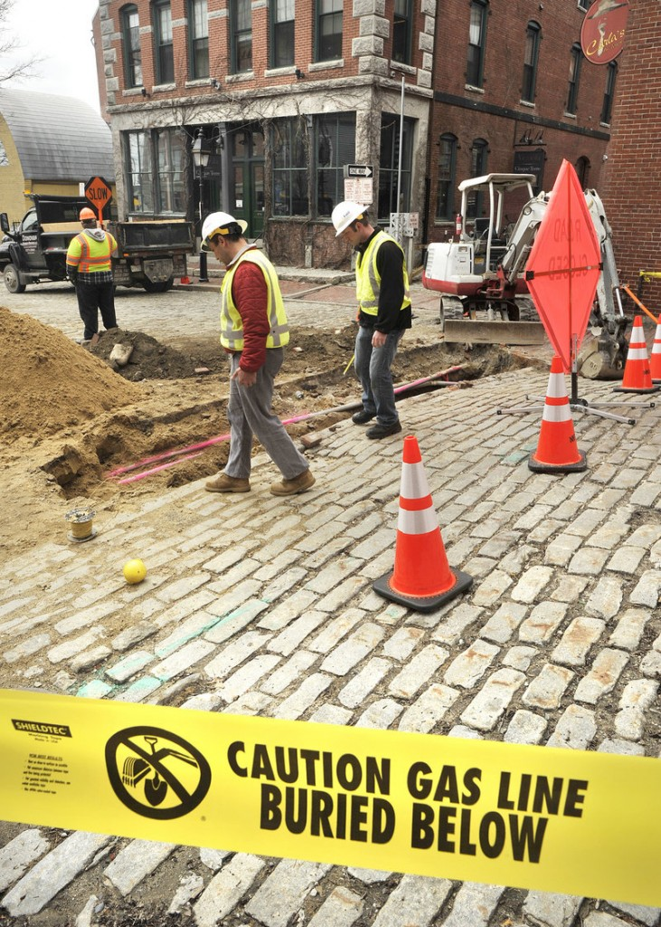 Unitil project manager Matt Doughty and project leader Joe Renda look over an excavation site in the Old Port. Unitil and its subcontractors plan to stop working on line installation by Memorial Day, the unofficial start of the tourist season.