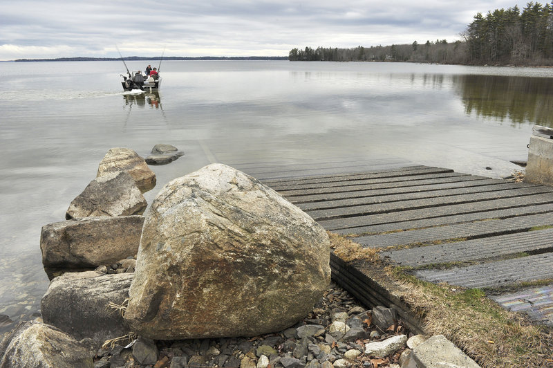 It still being early in the season, a boat heads onto Sebago Lake via a public launch that soon may have a long wait due to a lack of such facilities, especially on lakes and ponds in York and Cumberland counties.