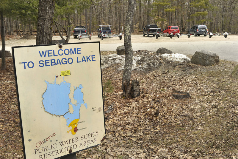 Trucks and trailers sit in the parking lot near the public boat launch at Sebago Lake, and those vehicles will soon increase in number.