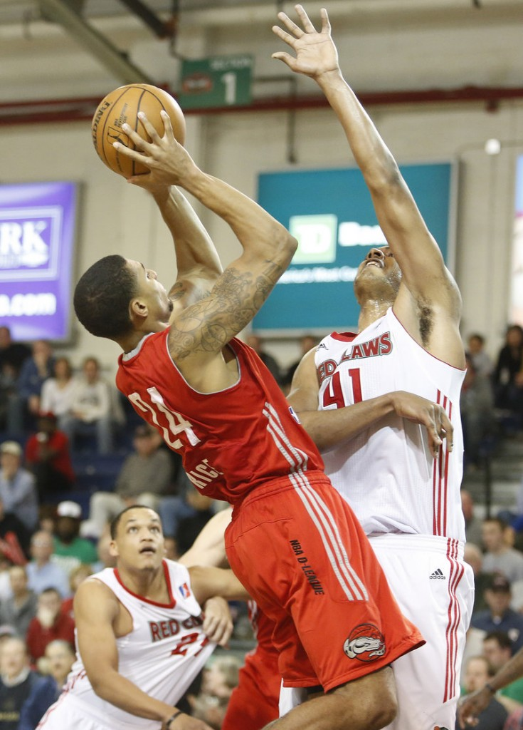 Glen Rice Jr. of the Rio Grande Valley Vipers finds a way to get a shot over Fab Melo of the Maine Red Claws in the third quarter of their D-League playoff game Thursday night at the Portland Expo. The Vipers held on, 120-118.