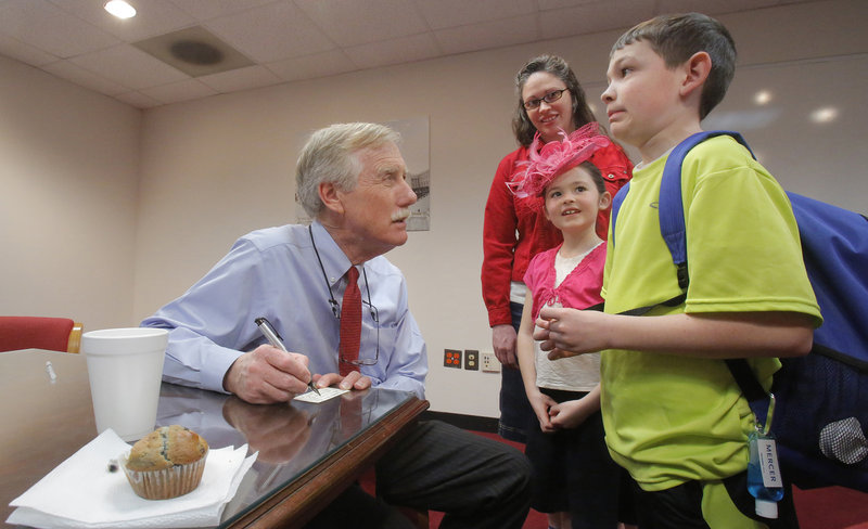 Nathan Little, 10, of Lewiston, who was visiting Washington with his mother, Jackie, and 8-year-old sister, Kristen, reacts Wednesday after Sen. Angus King asks him what kind of work senators do. King wrote a note for his teacher, explaining that Nathan should be excused from school since he was helping King with his work in Washington.