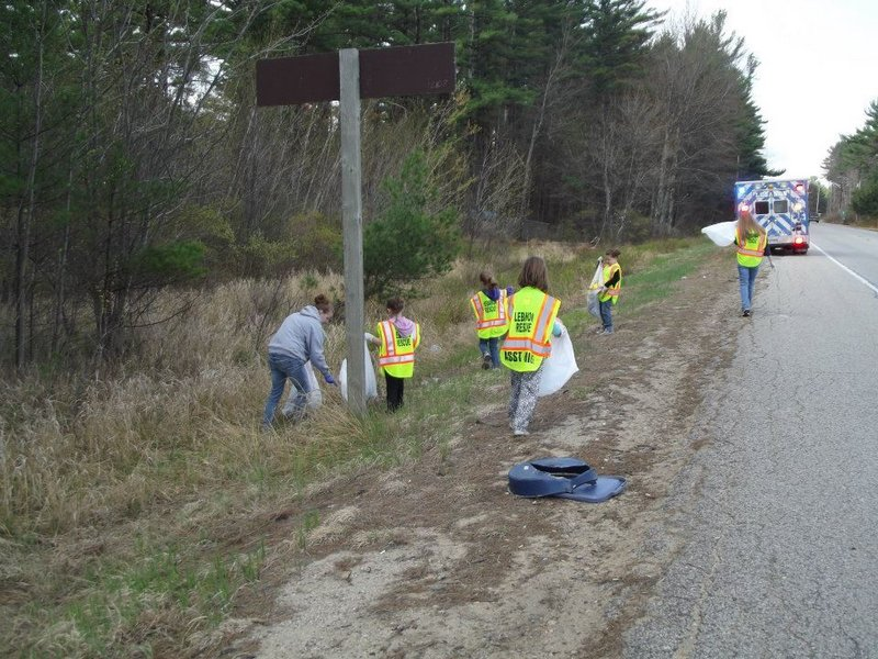 Lebanon Girl Scouts pick up litter beside the Carl Broggi Highway during the 2012 Lebanon Pride Day. This year's cleanup event is Saturday.