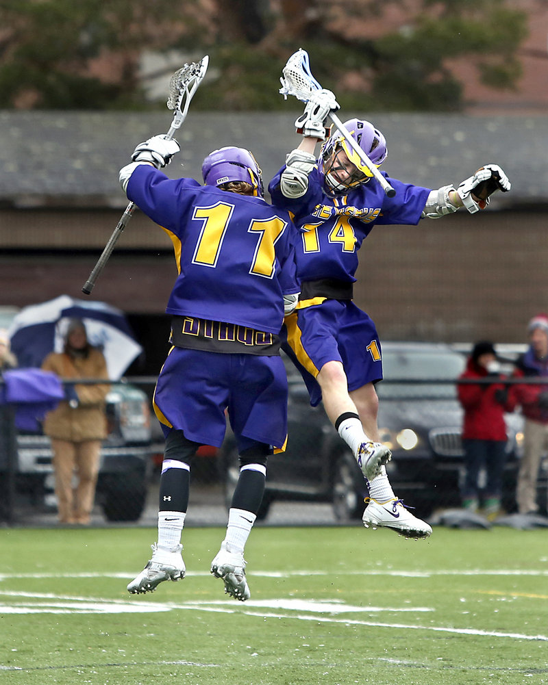Jack Sutton, left, celebrates with Warren Murray after Sutton scored to give Cheverus a 5-1 lead Friday in the second quarter against Deering. Sutton finished with five goals in a 12-6 victory.
