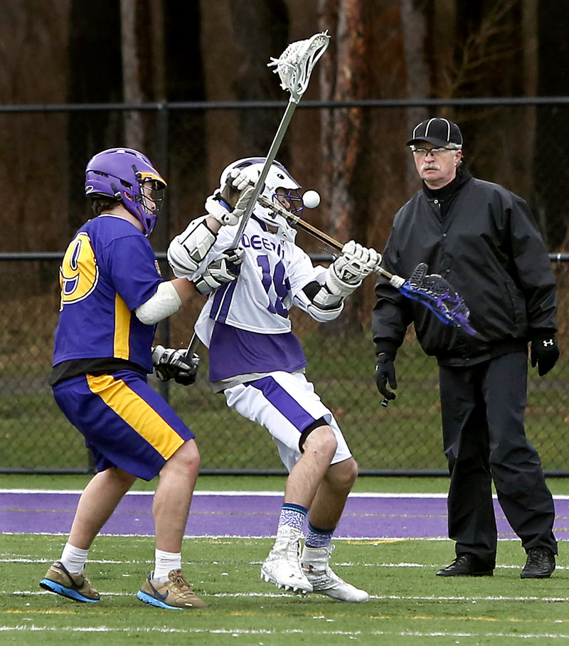 Alec Halpin, right, of Deering receives a close look at the ball as Mina Para of Cheverus defends in the second quarter. Halpin finished with three goals for the Rams.