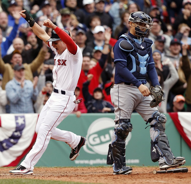 Jacoby Ellsbury crosses the plate with the winning run in the 10th inning Saturday, scoring on Shane Victorino's infield single to give the Red Sox a 2-1 victory against Tampa Bay. The catcher is Jose Lobaton.